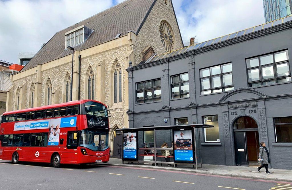 By Xero Xero branding on bus, stopping at the Xero bus stop outside the Xero London office